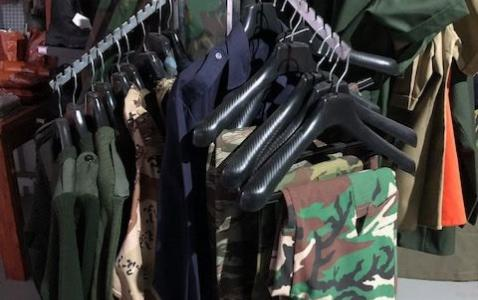 Showroom hanging uniforms.jpg